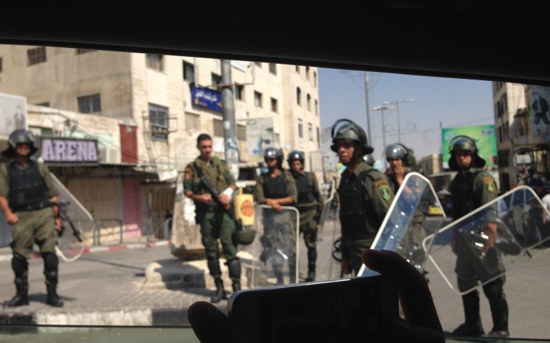 Palestinian police getting ready for the Friday demonstration. August 29, 2014. Photo: Masih Sadat