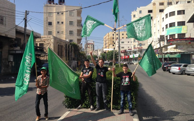 Young Palestinian boys on their way to the weekly demonstration in Hebron/al-Khalil. August 29, 2014. Photo: Masih Sadat