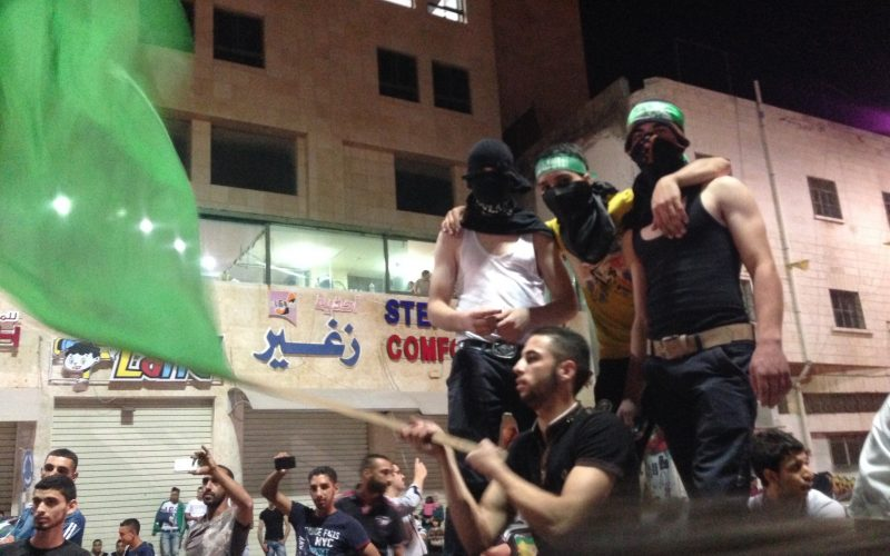 Palestinians in Al Khalil/Hebron celebrating what they see as a victory following the announcement of an open-ended ceasefire to the seven week long Gaza War a.k.a. Operation Protective Edge. August 26, 2014. Photo: Masih Sadat