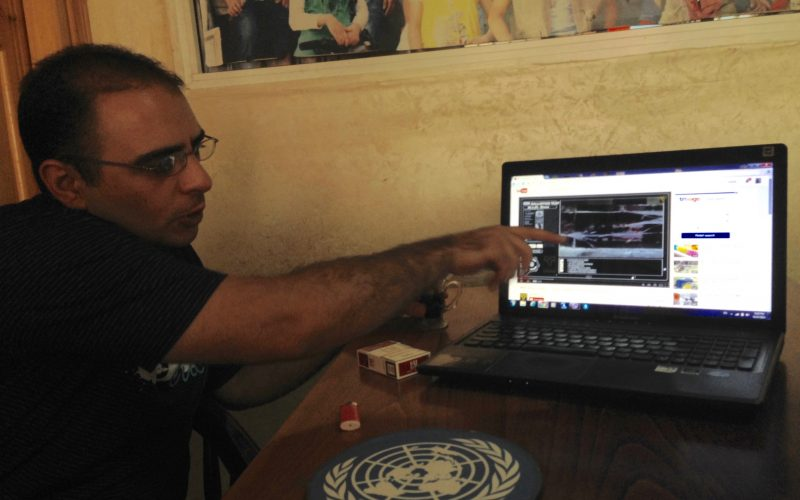 Mussa Qawasma showing us a video about the hollow-point bullet, in Hebron. August 27, 2014. Photo: Masih Sadat