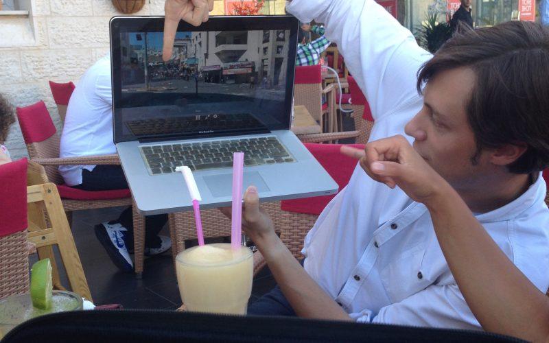 RT journalist Harry Fear in a café in Ramallah. Photo: Masih Sadat